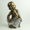 Indoor gold little monk in resin gold buddha statue
