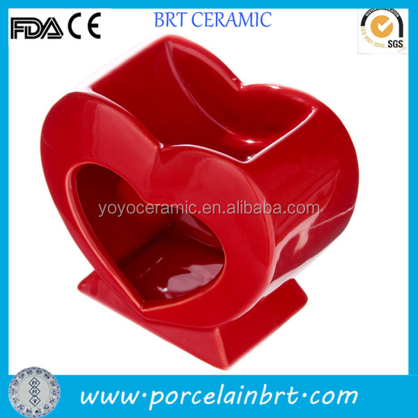 Red heart shaped ceramic tall candle holders for weddings