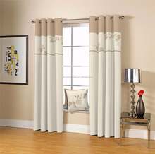 Beige curtain with matching cushion