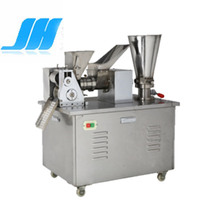 Automatic dumpling making machine