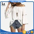 guangzhou clothing factory woman long bell sleeve pom pom trims off the shoulder blouse