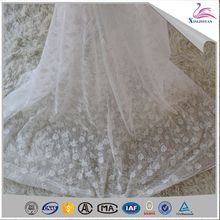 Popular eyelet embroidery net fabric with stones