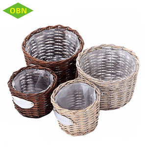 China Wholesale Price Handmade Cheap Garden Decor Plant Flower Wicker Basket Flower Pot with Plastic Lining