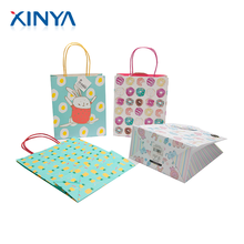 XINYA China Supplier Customised Shopping Gift Packaging Cartoon Craft Paper Bag With Logo
