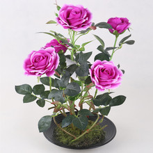 Artificial blooming purple rose with plastic