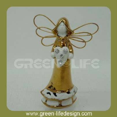 Gold color christmas angel with heart