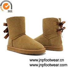 Furry flat sole winter boot with two back ribbon