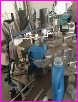 Full-automatic rotary under cover filling capping line in guangzhou indusry