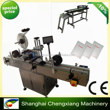 SHANGHAI LOWEST PRICE automatic film labeling machine,plastic bag labeling machine