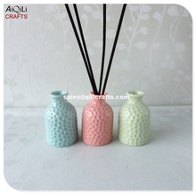 wholesale customized glossy glaze diffuser porcelain bottle with pit decoration