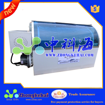 Drum skimmer for aquaculture
