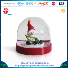 Plastic water snow globe with small snowman inside