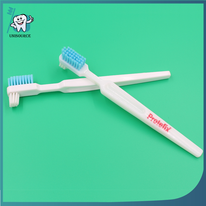 denture cleaning and holding toothbrush