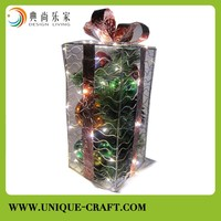 Metal Chritmas gift box with decorative pine cones and Chritmas color ball