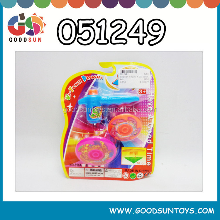 Promotional colorful wind up toy spinning top toy
