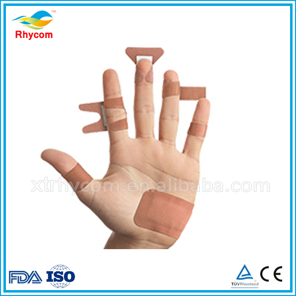 Highly absorbent cushion pad adhesive cohesive elastic bandage