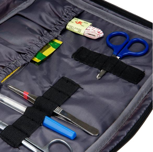 First aid emergency kit with home for wound dressings