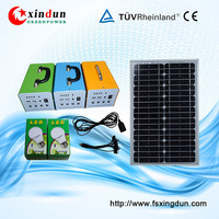 Hot sale portable mini solar home system 30W with mobile solar charger