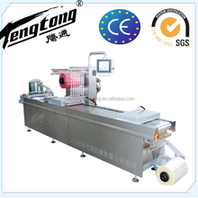 automatic food vacuum packing machine,automatic aquatic food thermoforming vacuum packaging machine