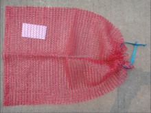 Red Raschel mesh bag with drawstring for packing potato