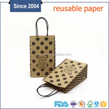 Customized polka dot paper bag with logo print for gift packaging