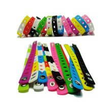 Ajustable size silicone bracelet with button rubber wristband