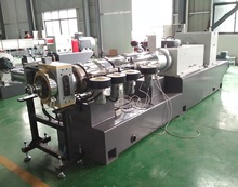 Counter rotating conical twin screw extruder