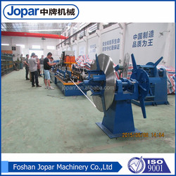 automatic black steel pipe spring roll making machine