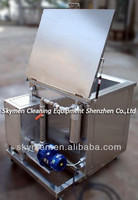 Fuel injector cleaning machine with oil filter system to recycle the solvent