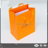 yellow shopping paper bag with gauze handle
