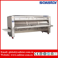 Automatic clothes ironing and folding machine