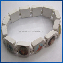 White wood stretch bracelet with assorted religious images, bracelet