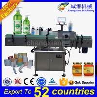 Trade assurance full auto adhesive labeling machine oil bottle,oil bottle labeling machine