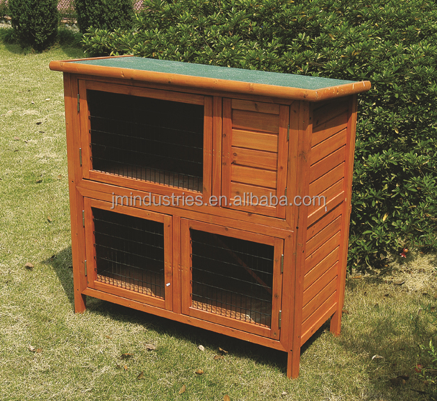 large wood hen house with metal tray