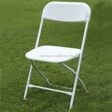 white plastic folding chair for outdoor event rental
