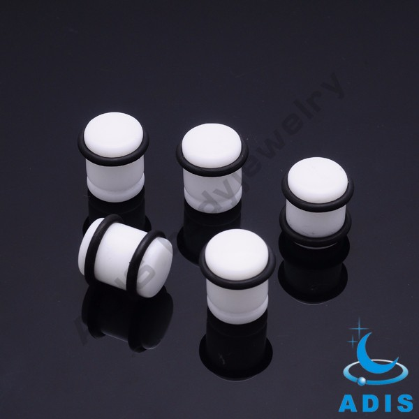 Wholesale jewelry white acrylic ear plugs expander piercings with black rings