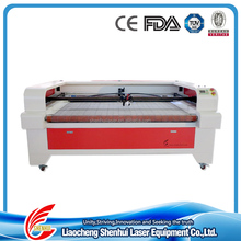 Hot sales swim ware fabric laser cutting puching machine vmade 1600*1000mm knitted woven jeans double heads laser cutti