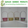 Colored bamboo basket for Easter with handle