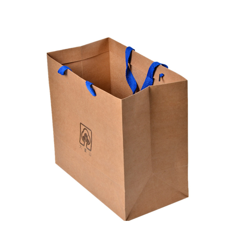 Cheap China brown kraft paper shopping bags with handle