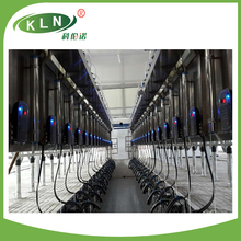 Parallel rapid exit cow milking machine