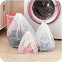 Hot selling custom logo nylon washing mesh wholesale drawstring laundry bags