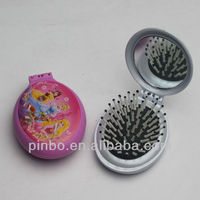 Folding hairbrush with mirror