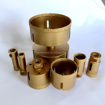 Vacuum brazed reinforced diamond core drill bits