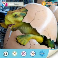 Colorful artificial animatronic baby dinosaur egg