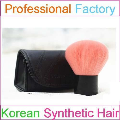 pink taklon kabuki brush with a black case