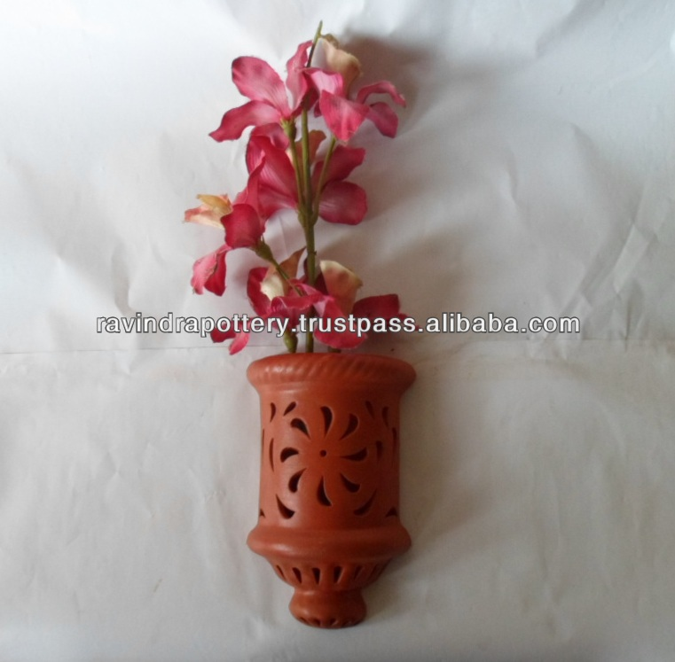 Decorative carved wall pot