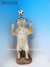meerkat playing football on Sandy beach ornaments