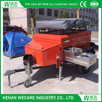Movable camping trailer with tent and stove