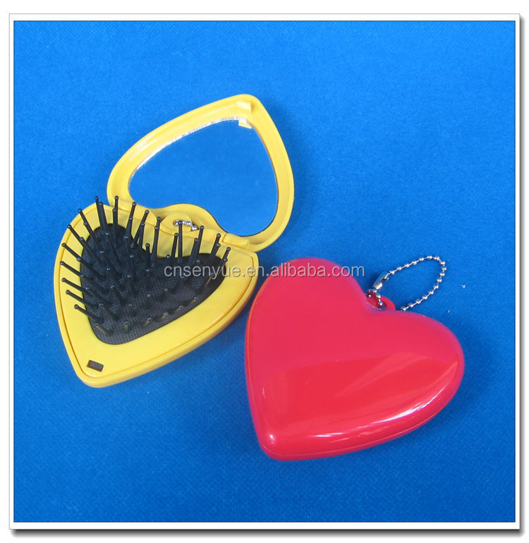 Beautiful small heart shaped compact mirror with comb