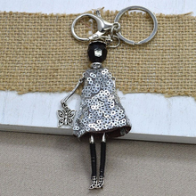 Fashion metal dress girl dance keychains,hot silver color skirt charm keychain with butterfly pendant